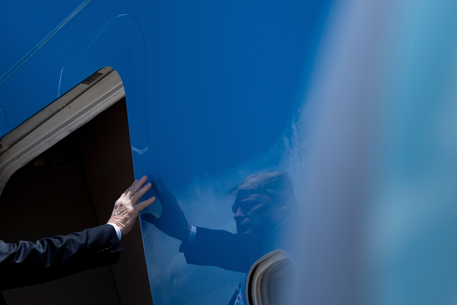 U.S. President Donald Trump boards Air Force One at Andrews Air Force Base in Maryland on May 14. BRENDAN SMIALOWSKI/AFP/Getty Images