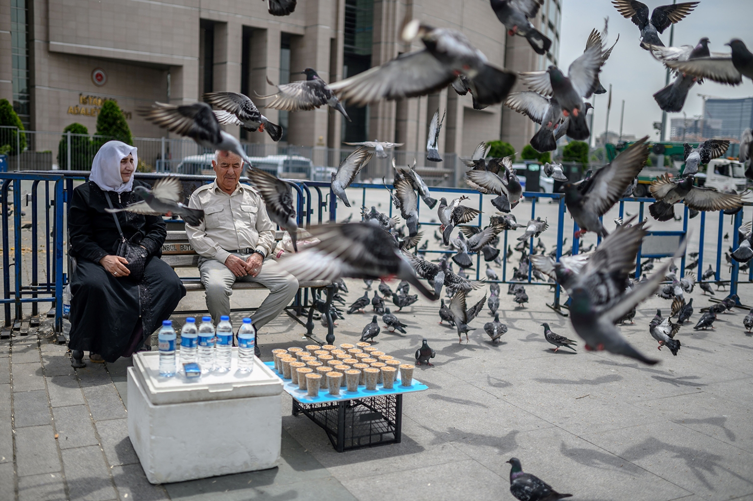 A couple sells food for feeding pigeons in front of the Caglayan courthouse in Istanbul on May 15. BULENT KILIC/AFP/Getty Images