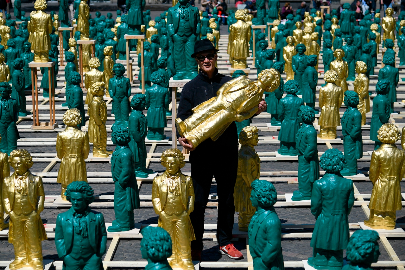 German conceptual artist Ottmar Hoerl poses next to some of his sculptures representing German composer Ludwig van Beethoven at the Muensterplatz square in Bonn, western Germany, on May 15. Around 700 sculptures by the artist are displayed in the city until June 2 as part of the festivities to mark the 250th anniversary of Beethoven's birth. INA FASSBENDER/AFP/Getty Images