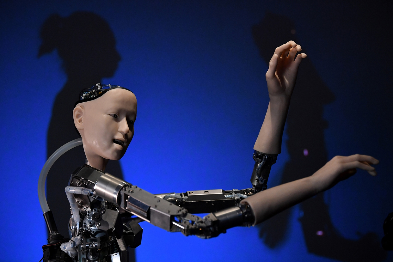 "A robot called Alter 3: Offloaded Agency is pictured during a event to promote the forthcoming exhibition titled ""AI: More than Human,"" at the Barbican Centre in London on May 15. BEN STANSALL/AFP/Getty Images"