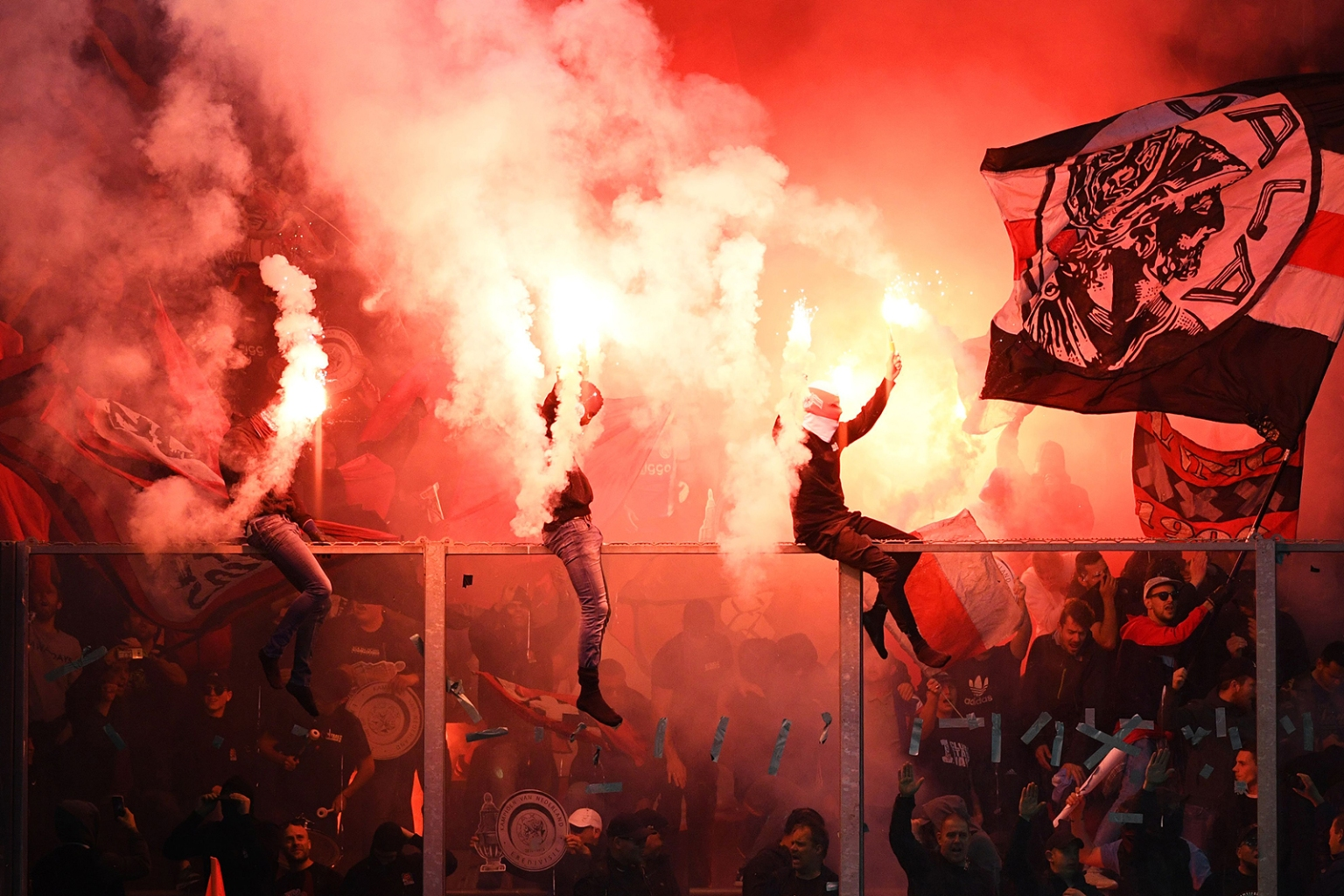 Ajax Amsterdam's supporters celebrate at the end of the Dutch Eredivisie football match between De Graafschap Doetinchem and Ajax Amsterdam in Doetinchem on May 15. OLAF KRAAK/AFP/Getty Images