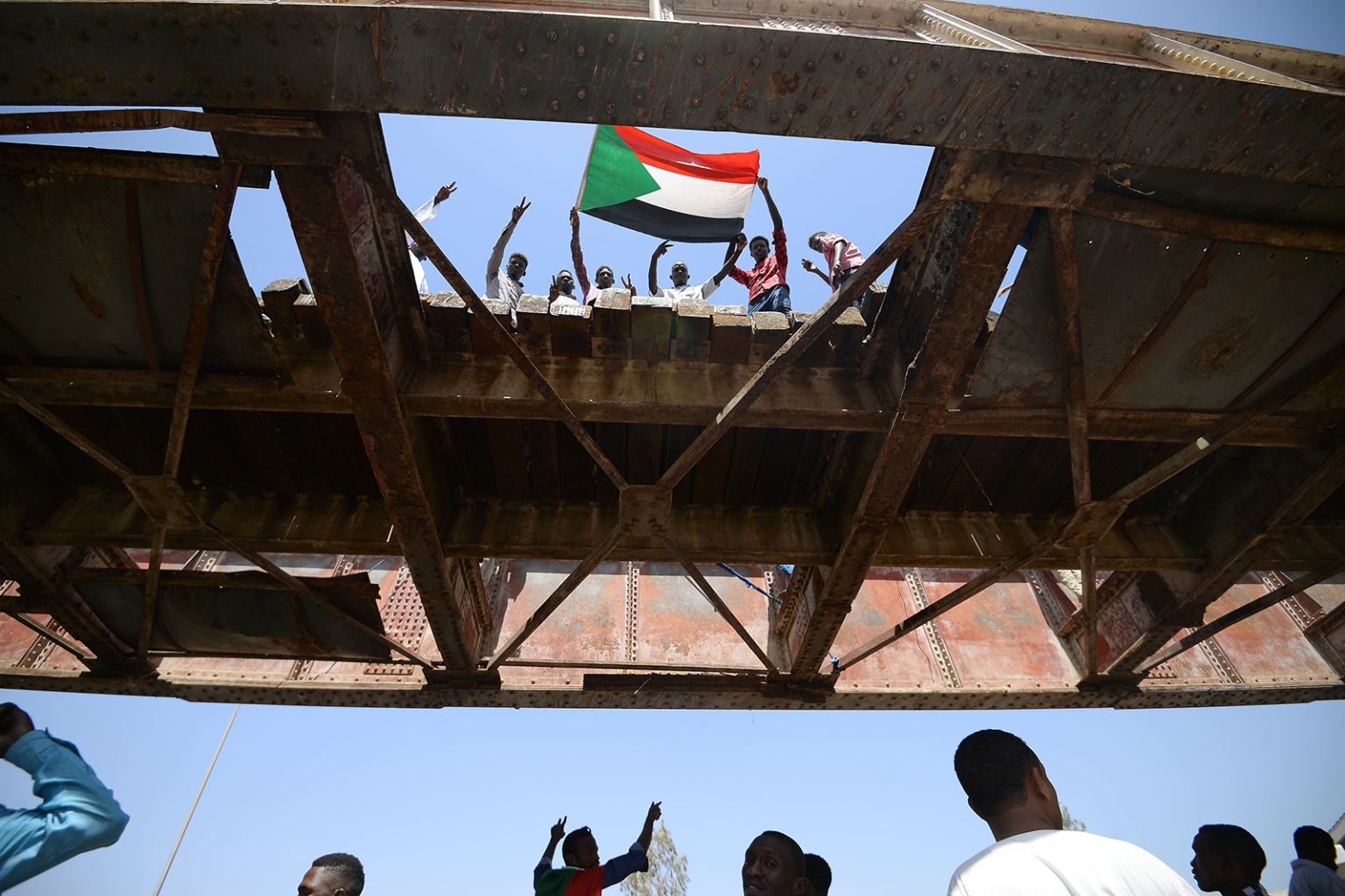 Sudanese protesters wave a national flag during an ongoing sit-in demanding a civilian-led government transition near the military headquarters in the capital Khartoum on May 17. MOHAMED EL-SHAHED/AFP/Getty Images