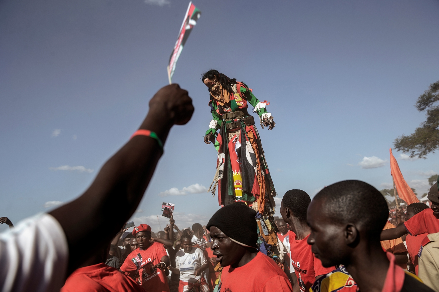 A traditional masked man on stilts entertains Malawi Congress Party leader and presidential candidate supporters waiting for his arrival at the last presidential campaign rally in Lilongwe on May 18. GIANLUIGI GUERCIA/AFP/Getty Images