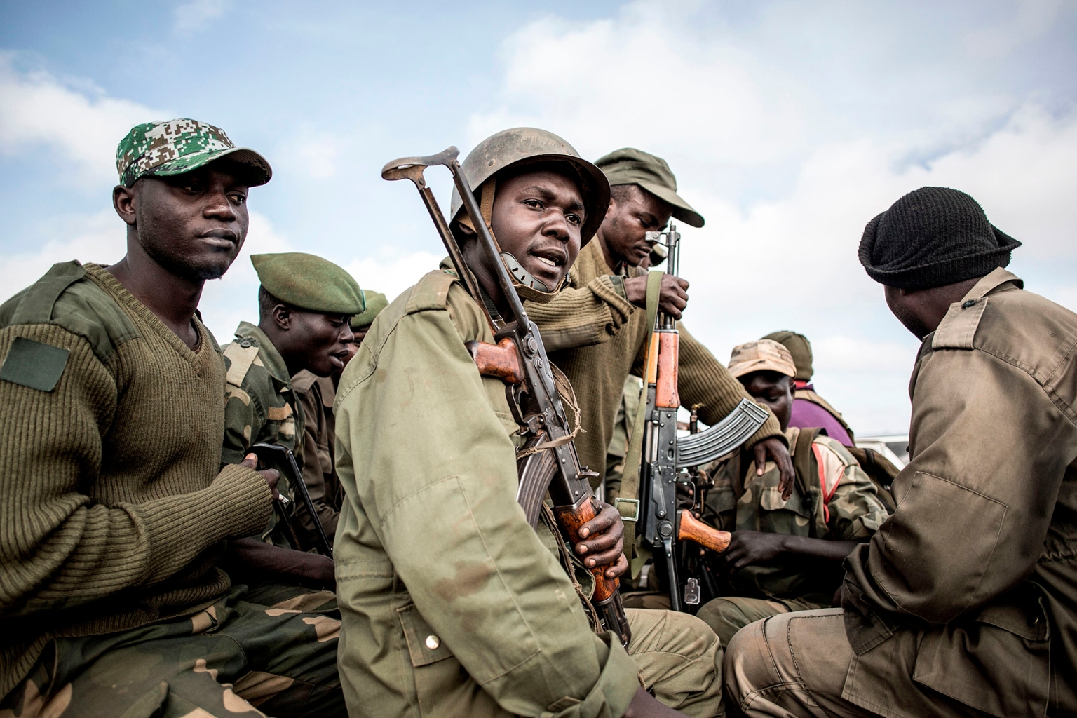 Soldiers of the armed forces of Democratic Republic of the Congo prepare to escort health workers attached to Ebola response programs in Butembo, north of Kivu, on May 18. JOHN WESSELS/AFP/Getty Images