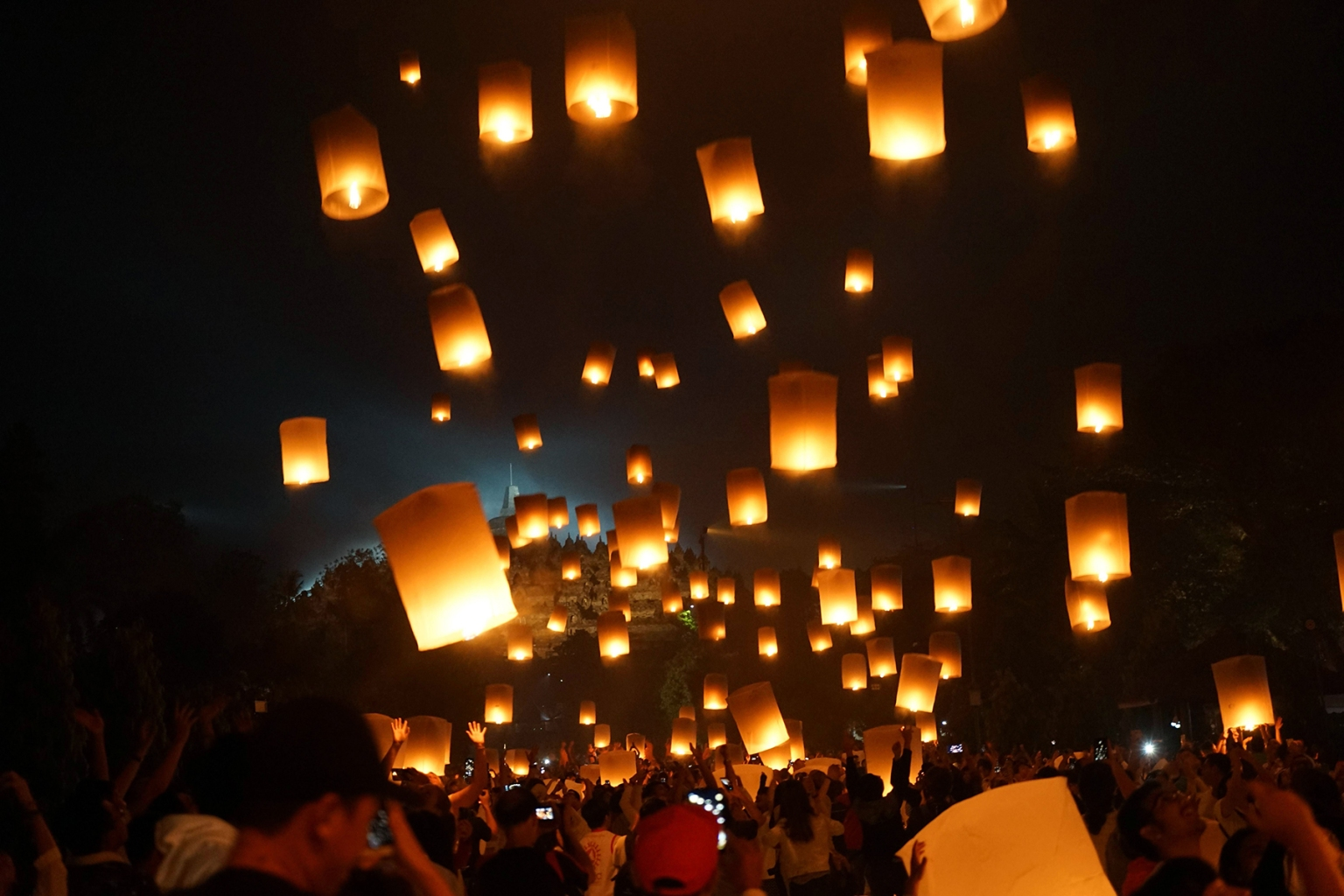 Buddhist devotees release lanterns into the air as a symbol of peace to honor Buddha's birthday at Borobudur temple in Magelang, Central Java, on May 19. OKA HAMIED/AFP/Getty Images