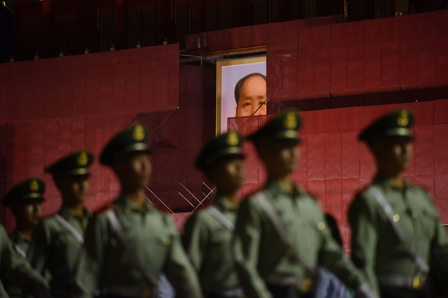 Paramilitary police officers marching past the portrait of late communist leader Mao Zedong on Tiananmen Gate as it undergoes renovations in Beijing on May 18. GREG BAKER/AFP/Getty Images