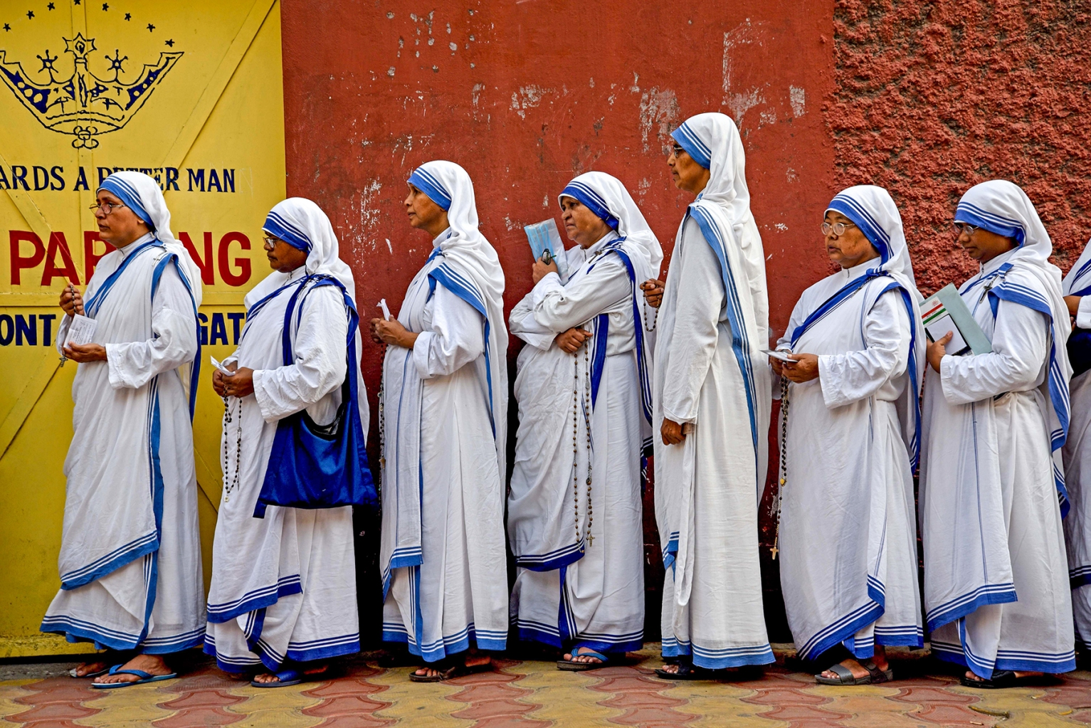 Indian nuns from the Mother Teresa Missionaries of Charities queue to cast their votes at a polling station at St. Mary's School in Kolkata on May 19 during the 7th and final phase of India's general election. AMIT DATTA/AFP/Getty Images