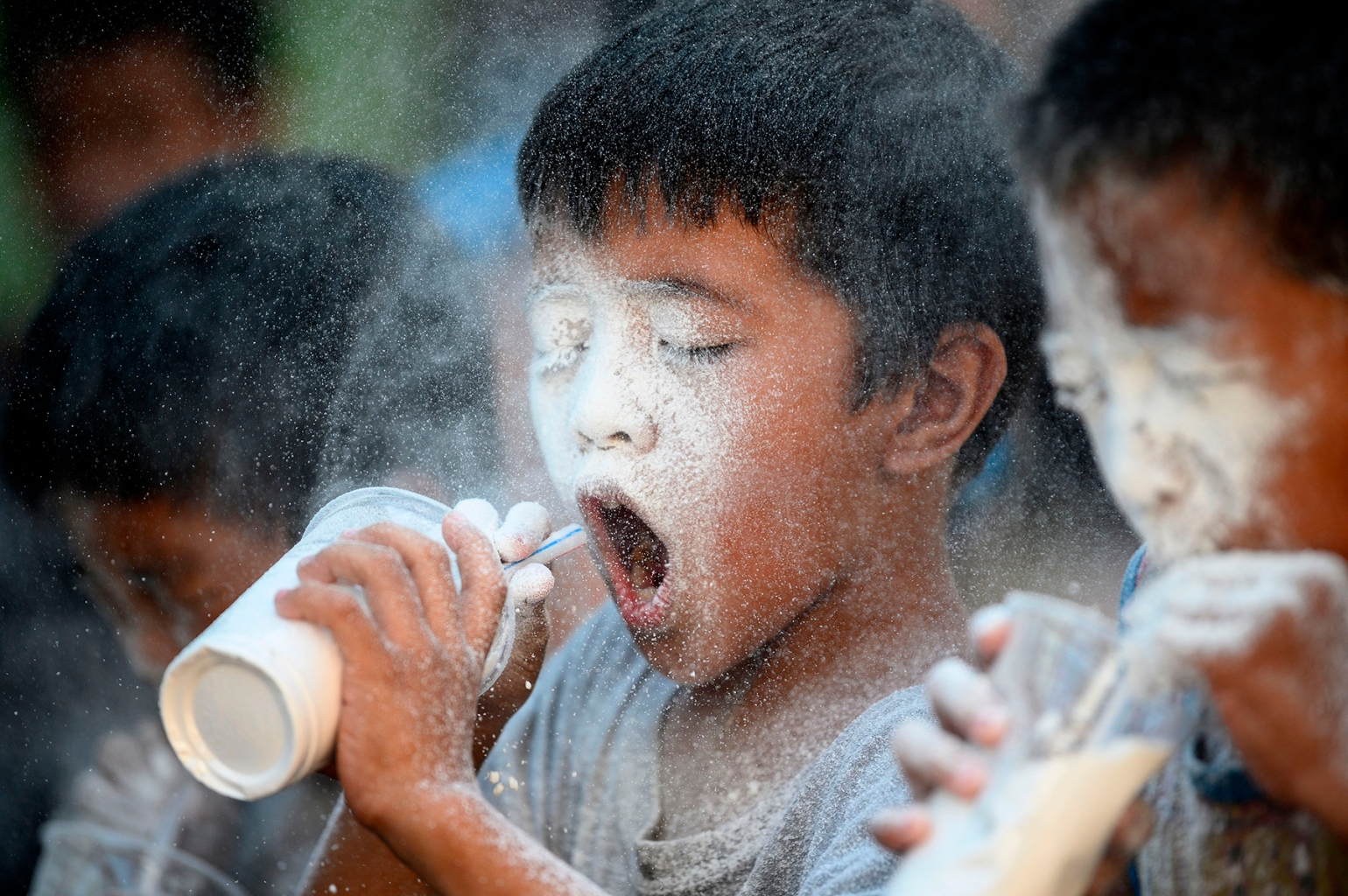 Boys try to empty cups filled with flour by blowing through a straw in a parlor game during the annual Feast Day of St. Rita of Cascia in Manila, Philippines, on May 19. NOEL CELIS/AFP/Getty Images