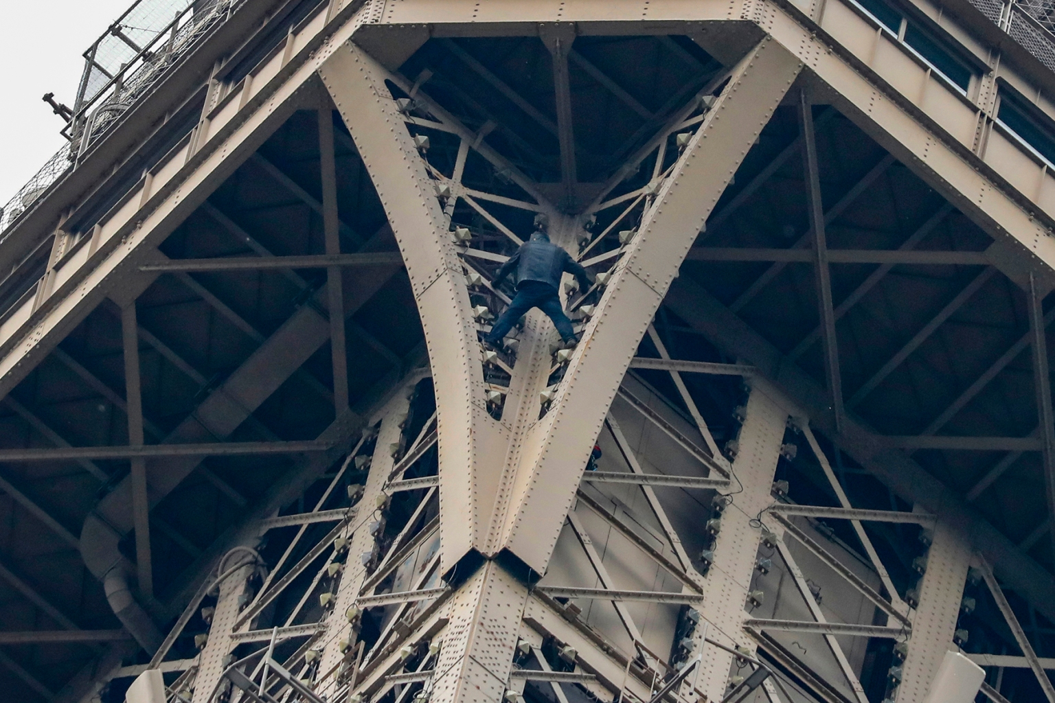 A man climbs to the top of the Eiffel Tower, in Paris, without any protection, on May 20. The Eiffel Tower was evacuated after someone was spotted climbing the Paris landmark. FRANCOIS GUILLOT/AFP/Getty Images