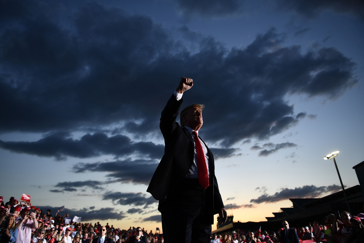 U.S. President Donald Trump walks by his supporters as he leaves his Make America Great Again rally in Montoursville, Pennsylvania, on May 20. BRENDAN SMIALOWSKI/AFP/Getty Images