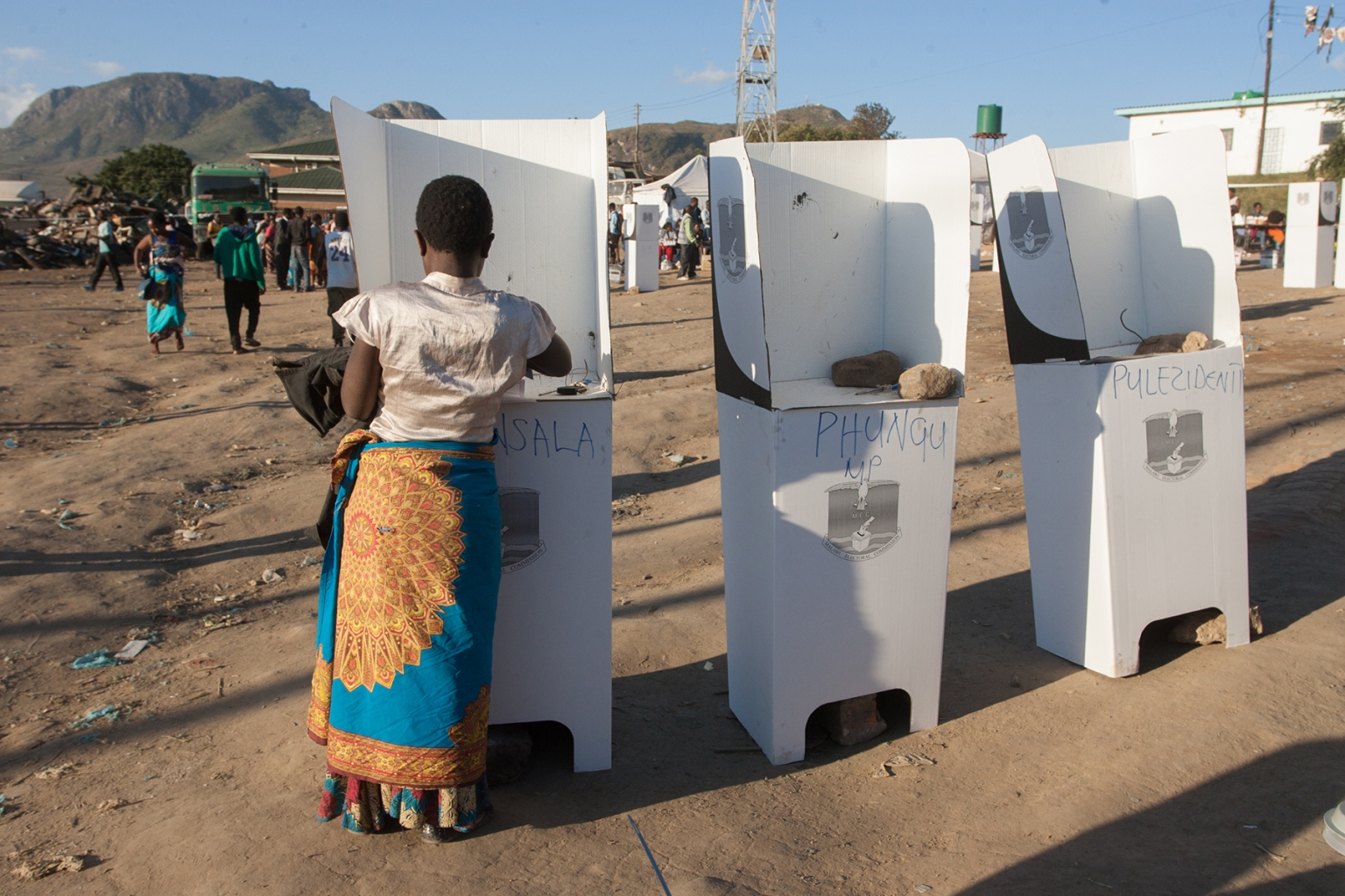 A woman casts her vote at the Ndirande Community ground polling center in Blantyre, southern Malawi, during the country general elections on May 21. AMOS GUMULIRA/AFP/Getty Images