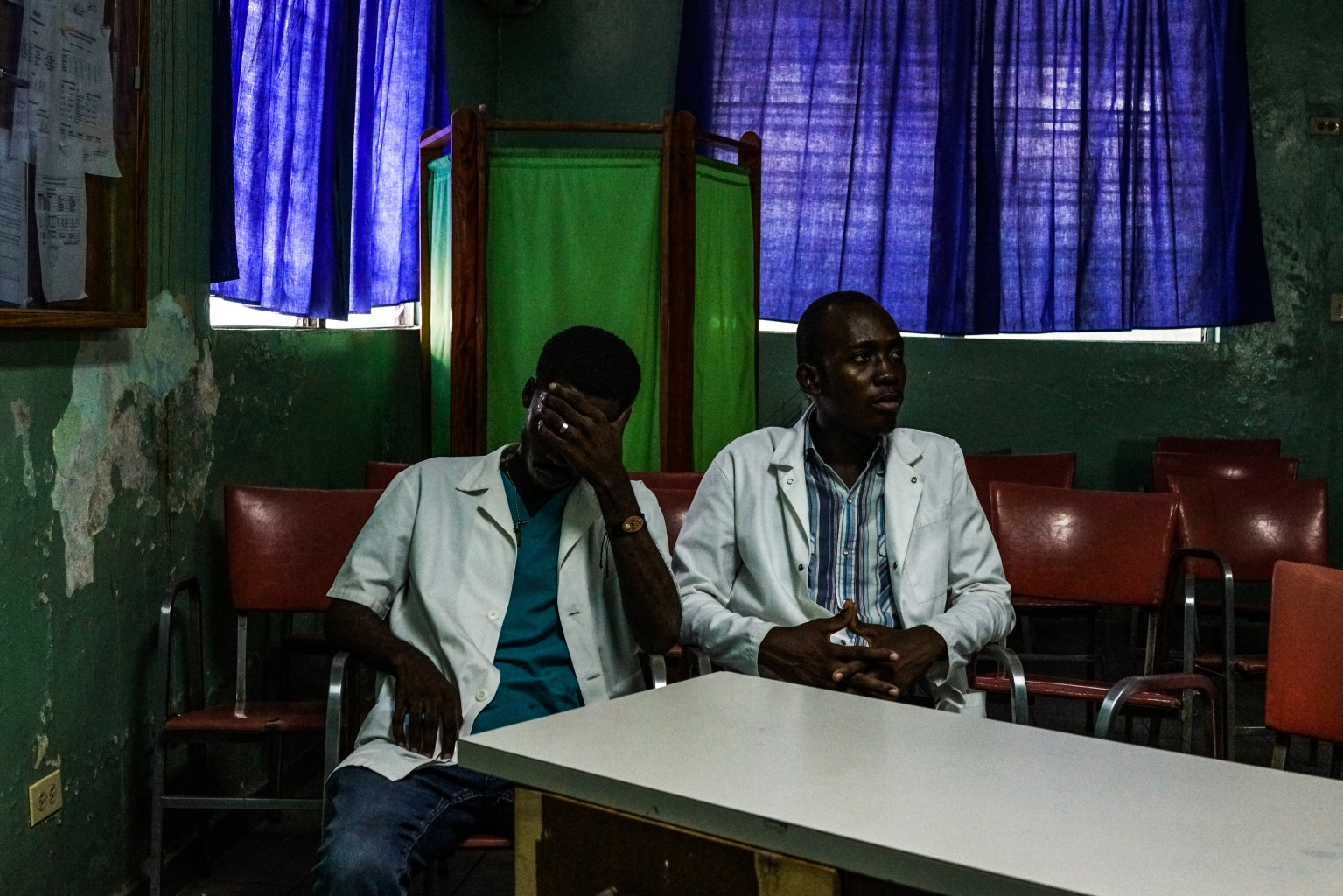 Junior doctors sit inside a room during a doctors' strike at a public hospital in Port-au-Prince, Haiti, on May 21. CHANDAN KHANNA/AFP/Getty Images