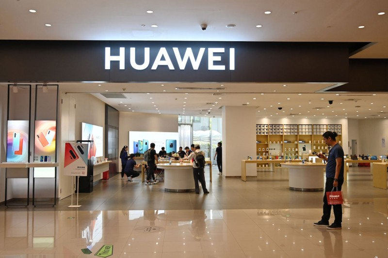 People browse for items in a Huawei store in a shopping mall in Shanghai on May 22, 2019.