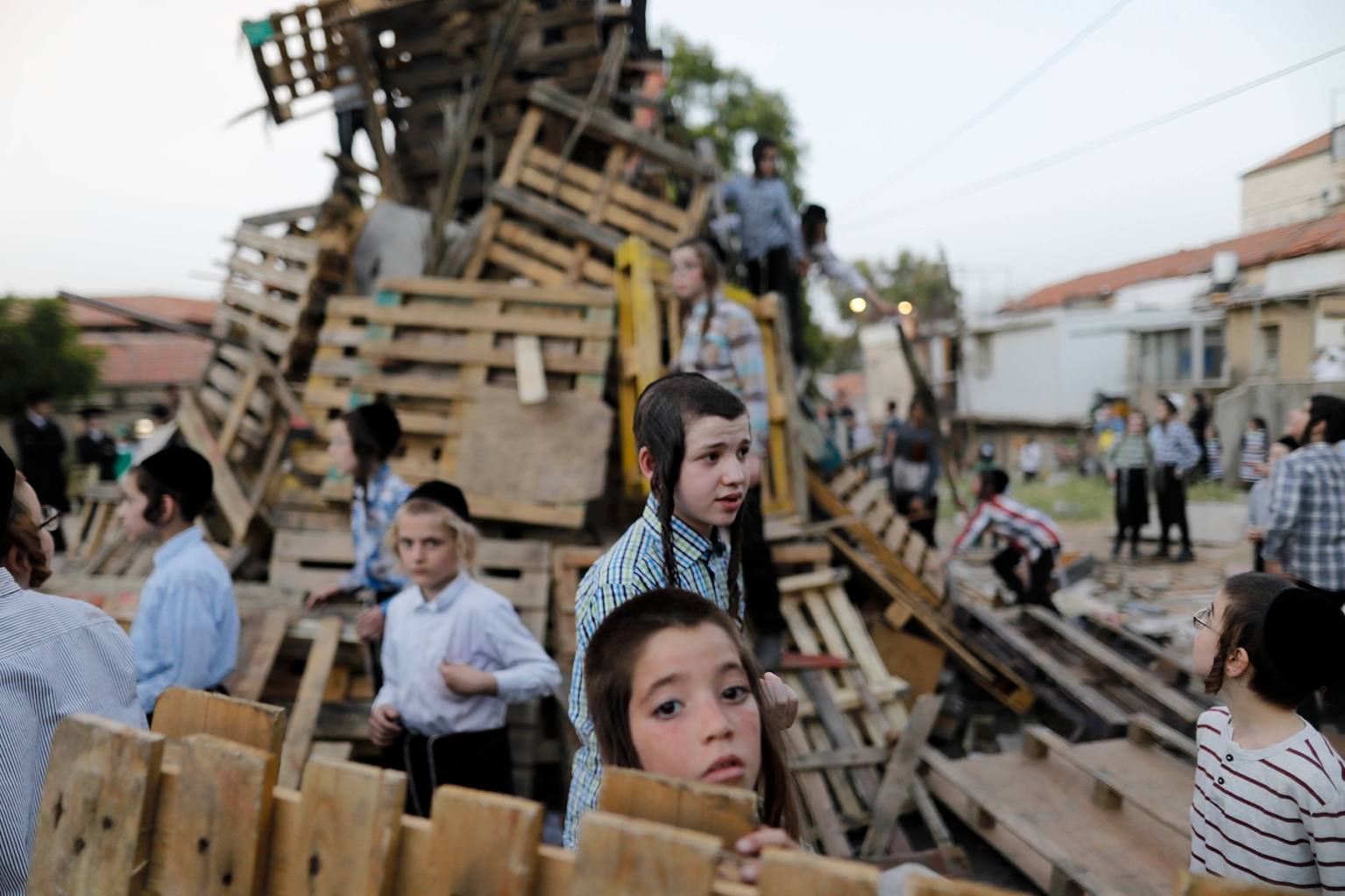 Ultra-Orthodox Jewish children built a bonfire to be lit in the evening in Jerusalem's Mea Shearim neighborhood on May 22 to celebrate the Jewish holiday of Lag BaOmer, marking the anniversary of the death of Talmudic sage Rabbi Shimon Bar Yochai approximately 1,900 years ago. MENAHEM KAHANA/AFP/Getty Images