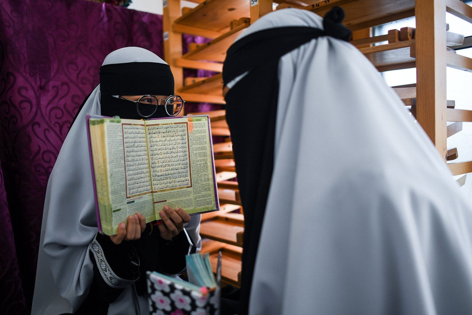 Muslim students read copies of the Quaran to observe Nuzul Quran, when the beginnings of the holy book were revealed to the Prophet Mohammed, in a mosque in Bentong on May 22. MOHD RASFAN/AFP/Getty Images