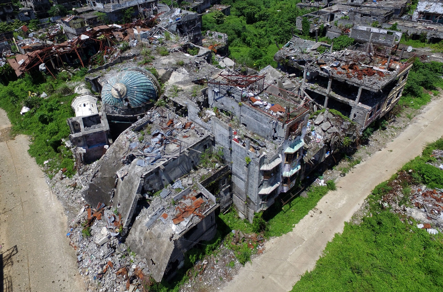 An aerial photo shows a destroyed mosque in Marawi on the southern island of Mindanao on May 23. Two years after the Philippine city of Marawi was overrun by jihadists, it remains in ruins, with experts warning that stalled reconstruction efforts are bolstering the appeal of extremist groups in the region. NOEL CELIS/AFP/Getty Images