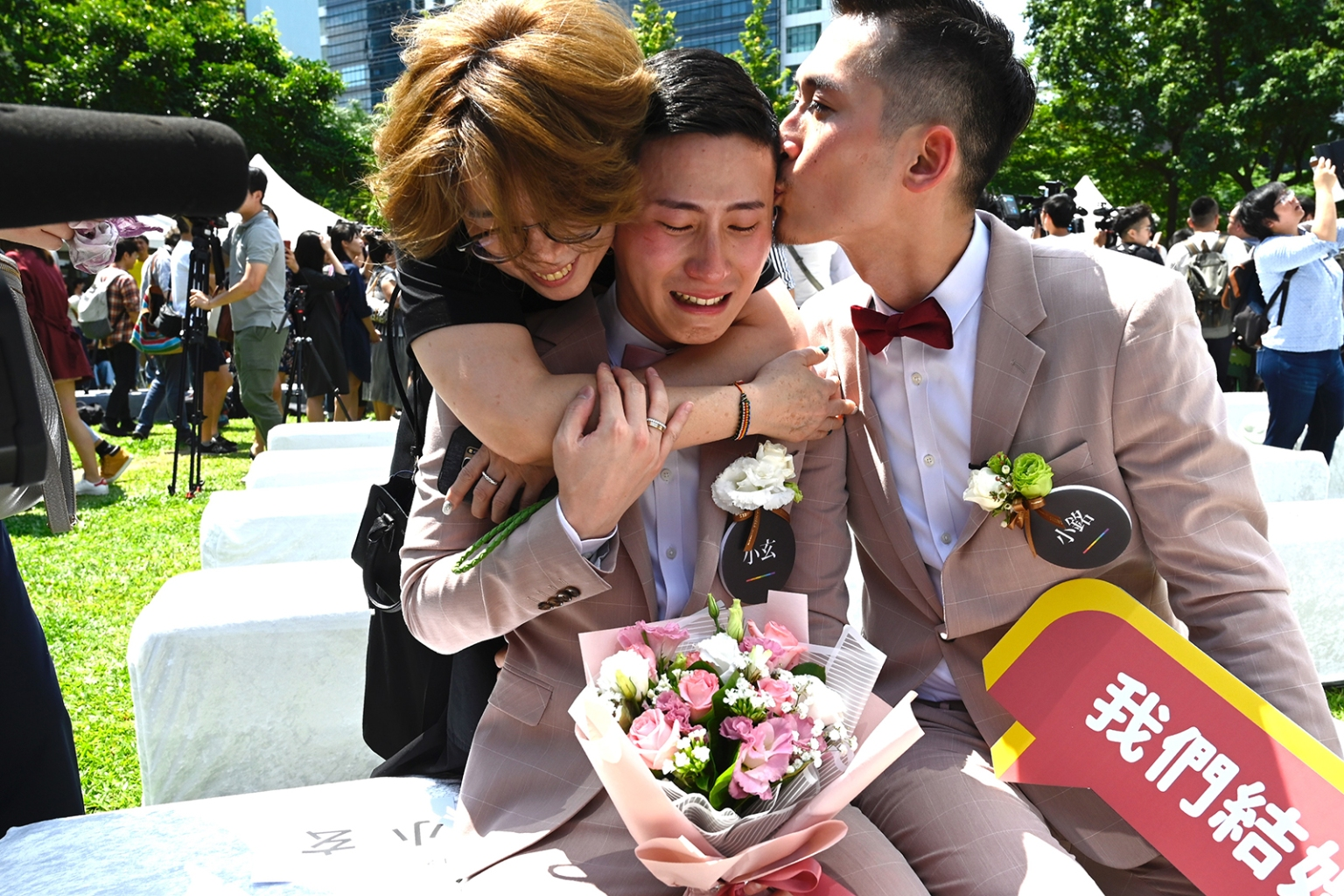 Shane Lin is comforted by his partner Marc Yuan and a friend during a wedding ceremony in Shinyi district in Taipei on May 24 after Taiwan voted to recognize same-sex marriage. SAM YEH/AFP/Getty Images