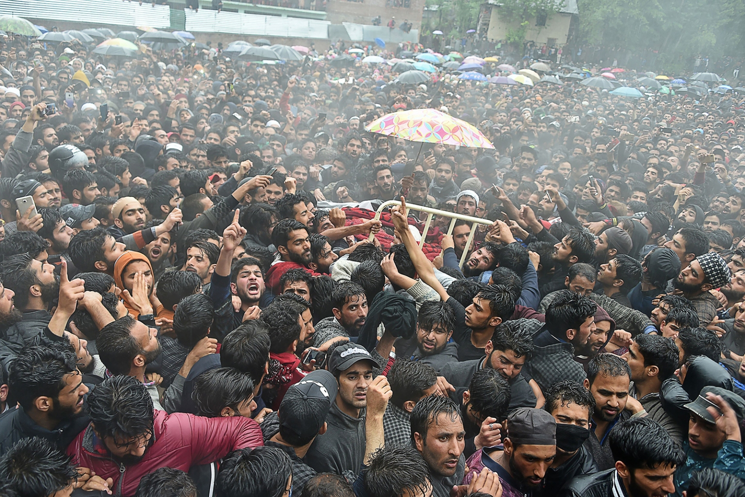Kashmiri villagers carry the body of top militant commander Zakir Musa of the Ansar Ghazwat-ul-Hind group, which claims affiliation with al Qaeda, during a funeral procession at Dadsar village in Tral, south of Srinagar, on May 24. TAUSEEF MUSTAFA/AFP/Getty Images
