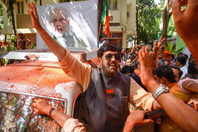 BJP party supporters celebrate electoral victory on May 23, 2019 in Pune, India.