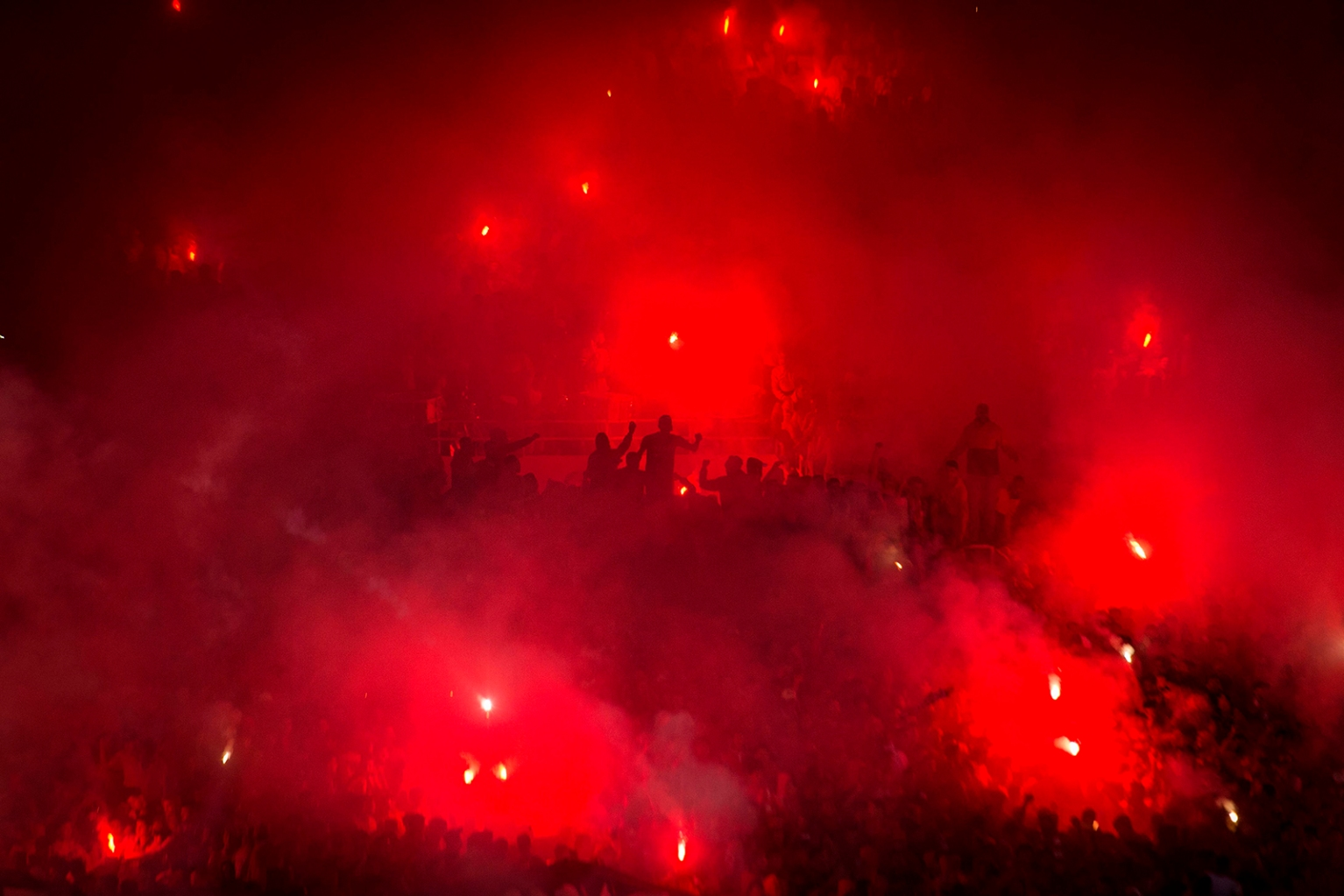 Wydad's supporters light flares during the Confederation of African Football Champions League soccer match between Morocco's Wydad Athletic Club and Tunisia's Esperance sportive de Tunis in Rabat on May 24. FADEL SENNA/AFP/Getty Images