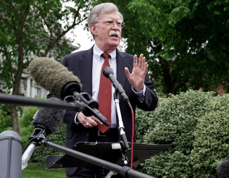 White House National Security Advisor John Bolton talks to reporters outside the West Wing in Washington on May 1.