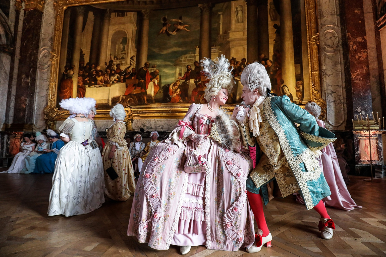 An Italian Venitian couple dressed in period costumes pose as they take part in the Fetes Galantes fancy dress evening at the Chateau de Versailles on May 27. LUDOVIC MARIN/AFP/Getty Images