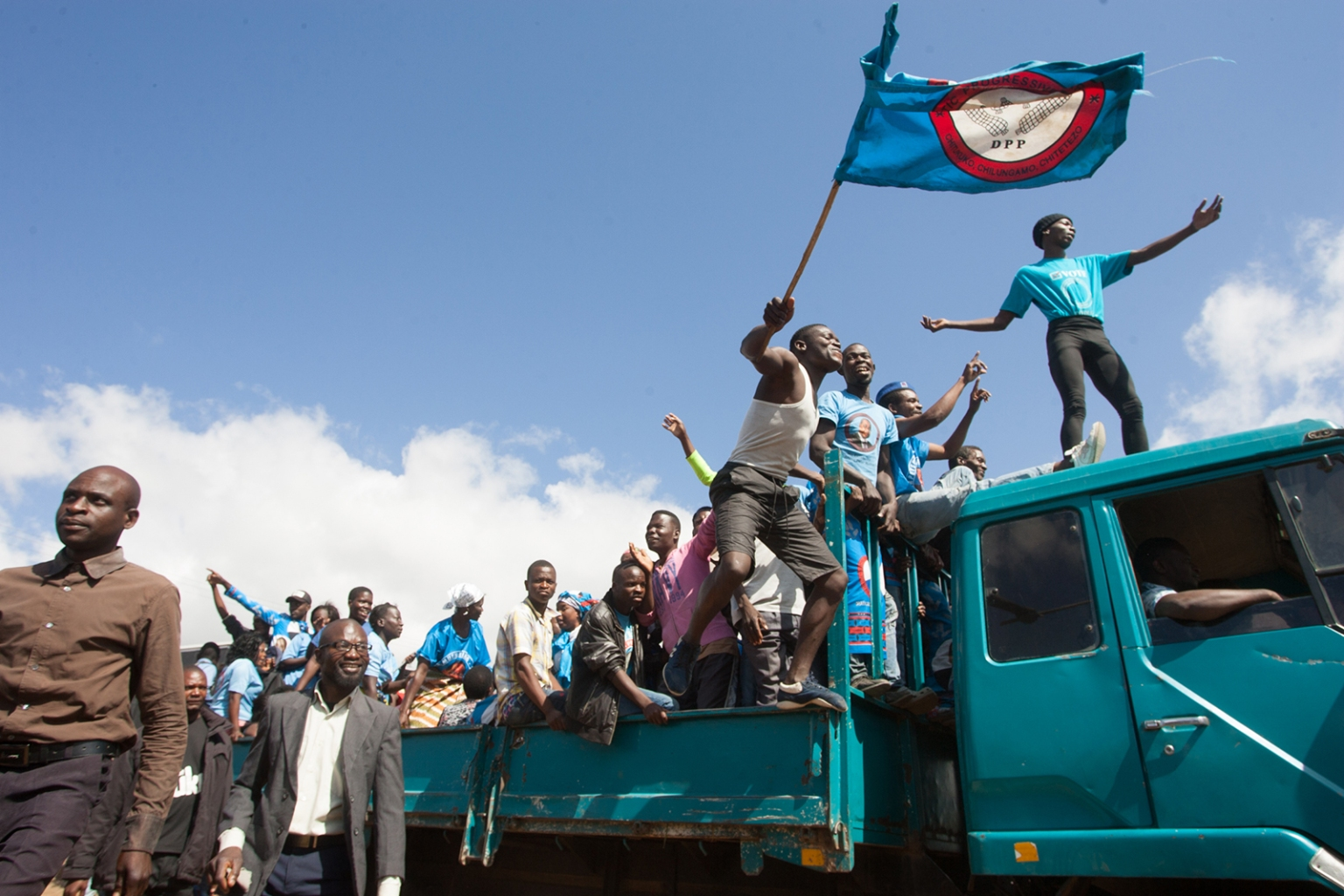 Supporters of Malawi's ruling Democratic Progressive Party celebrate during the swearing-in ceremony of president-elect Peter Mutharika at Kamuzu Stadium in Blantyre on May 28, after a contentious election marred by allegations of fraud and vote-rigging. AMOS GUMULIRA/AFP/Getty Images