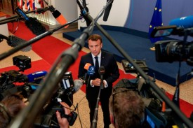 Emmanuel Macron speaks to the press as he leaves after a European Union (EU) summit at EU Headquarters in Brussels on May 28.