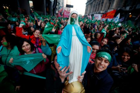 Argentinian activists with green handkerchiefs, which symbolize the abortion rights movement, demonstrate to mark the revival of their campaign to legalize abortion in Buenos Aires on May 28. EMILIANO LASALVIA/AFP/Getty Images