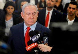Israeli Prime Minister Benjamin Netanyahu talks to the press following a vote on on May 29 in Jerusalem.