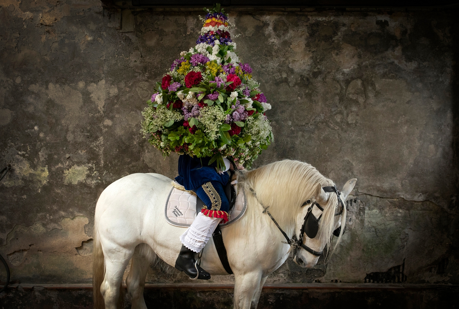 """The King,"" Johnathon Haddock, poses for a portrait with the garland before the procession during Castleton Garland Day in Castleton, England, on May 29. The event dates to the 1700s and is believed to be an ancient fertility rite with Celtic connections. Dan Kitwood/Getty Images"