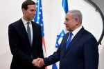 Israeli Prime Minister Benjamin Netanyahu, right,  shakes hands with Jared Kushner, U.S. President Donald Trump's senior advisor, in Jerusalem on May 30.