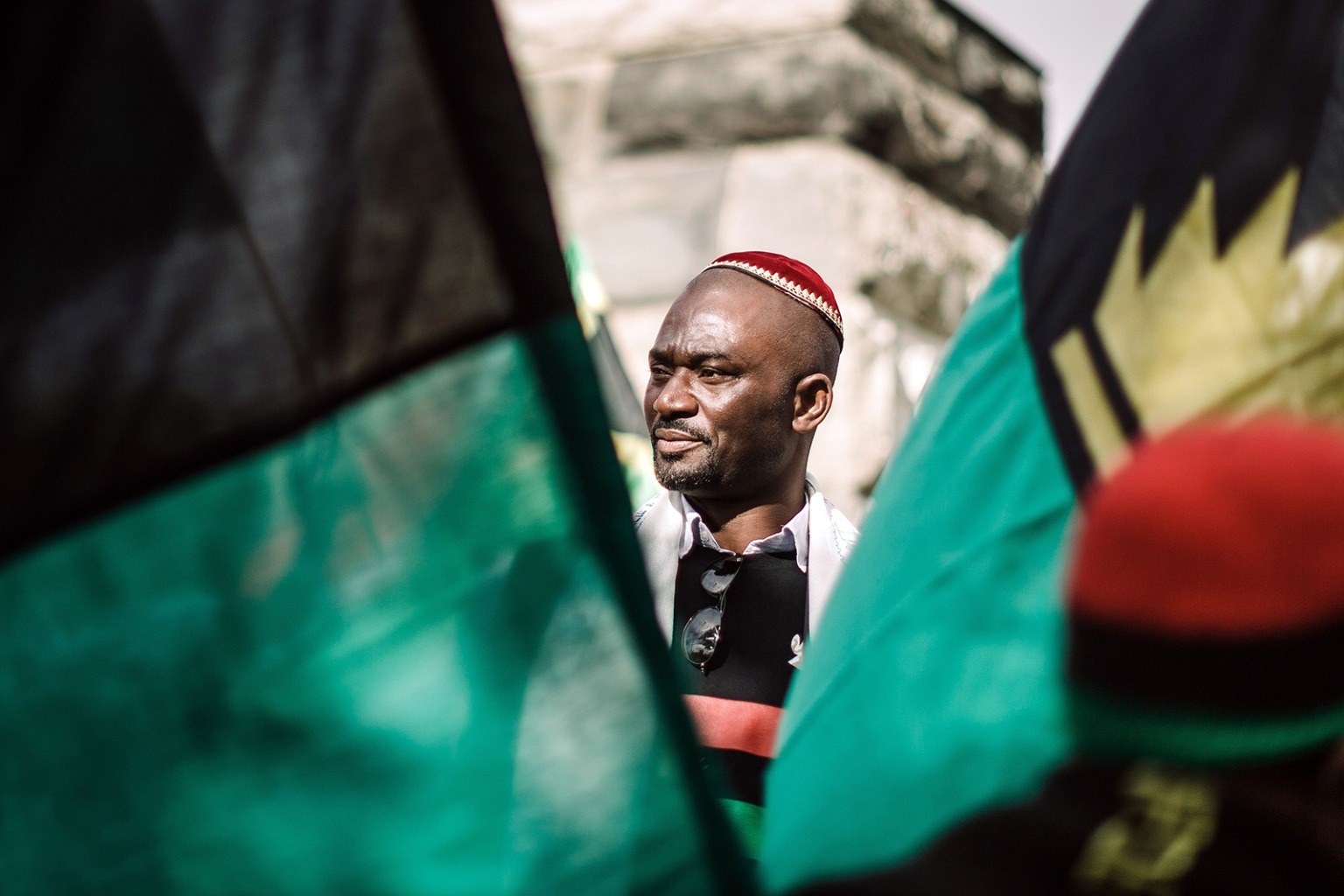 A protestor between Biafra flag takes part in a demonstration in Durban, South Africa, on May 30. The Freedom March for Biafra, held worldwide and organized by the Indigenous People of Biafra, marks the anniversary of the unilateral declaration of independence in 1967 that sparked a brutal 30-month civil war in Nigeria. RAJESH JANTILAL/AFP/Getty Images
