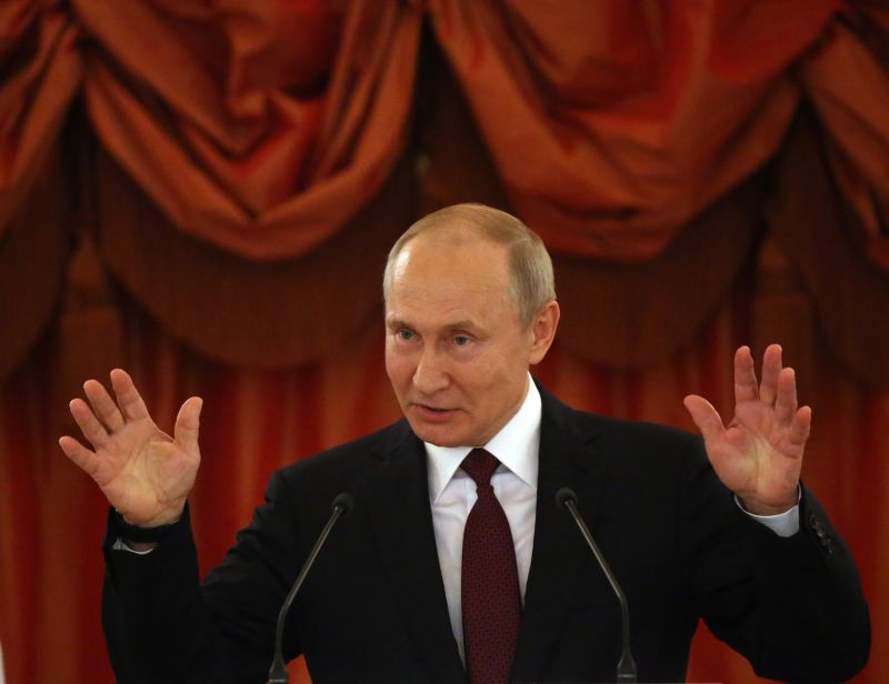 Russian President Vladimir Putin gestures during the awarding ceremony of the Order of Parental Glory at the Grand Kremlin Palace in Moscow on May 30.