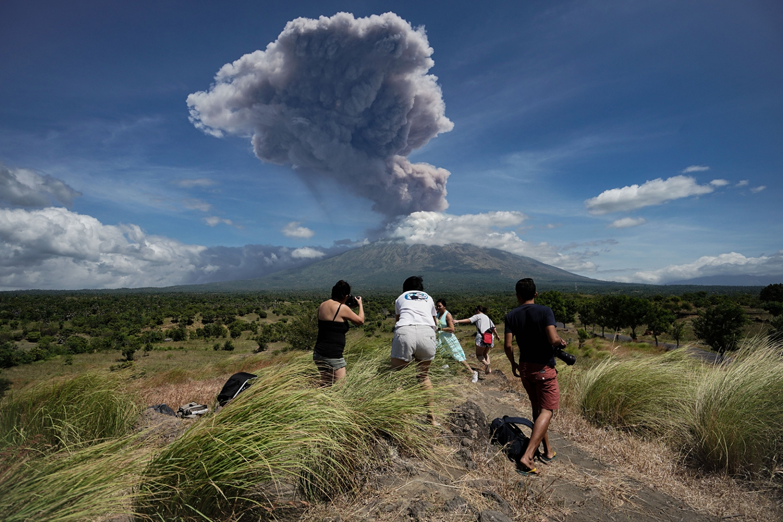 Mount Agung volcano releases a plume of ash, as seen from the Kubu subdistrict in Karangasem Regency on Indonesia's resort island of Bali on May 31. MADE ALIT SUANTARA/AFP/Getty Images