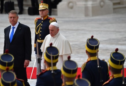 Romanian President Klaus Iohannis and Pope Francis inspect an honor guard at the presidential palace in Bucharest on May 31.