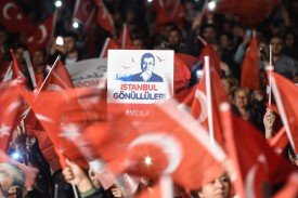 Supporters of Ekrem Imamoglu cheer as they protest the announcement from Turkey's electoral body that Istanbul's local elections will be rerun on June 23.