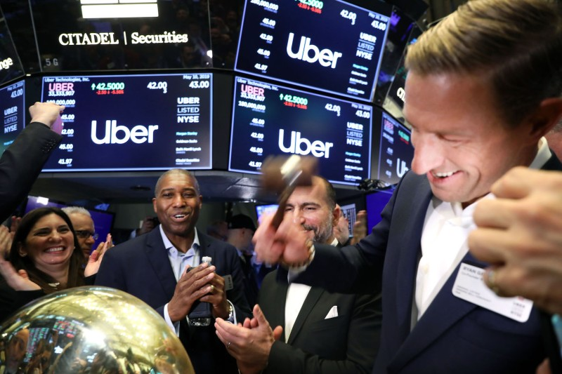 Former CEO Ryan Graves rings a ceremonial bell signifying the first trade as the ride-hailing company Uber makes its highly anticipated initial public offering in New York City on May 10.