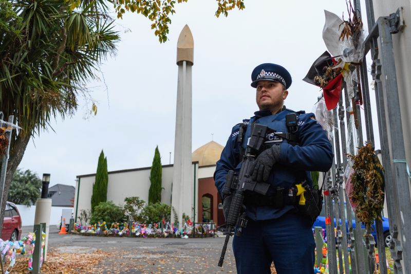An armed police officer is seen in front of Al Noor Mosque in Christchurch, New Zealand, on May 11.