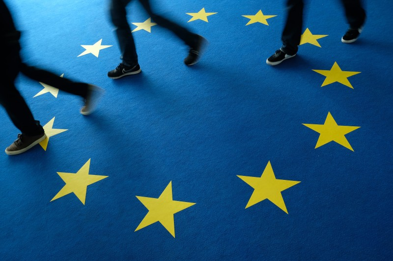 People walk across carpeting with the EU flag  at the German Christian Democrats (CDU) headquarters during European Parliament elections on May 26 in Berlin, Germany.