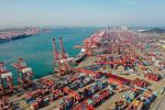 Shipping containers sit stacked at Qingdao Port in China on May 28.