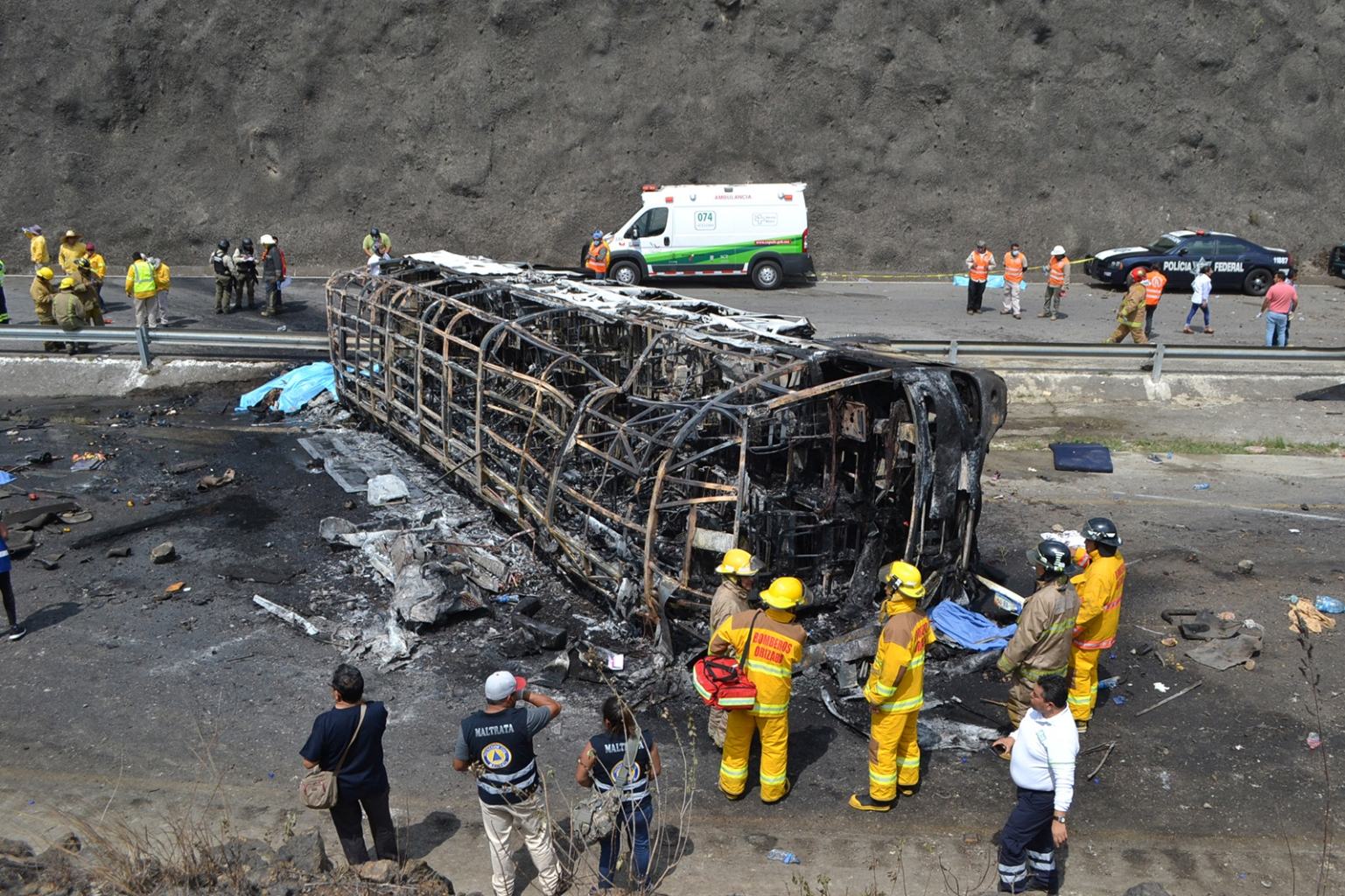 Rescuers and firemen work after a crash between a bus carrying Catholic pilgrims and a semi on a mountain road in Veracruz close to Maltrata, Mexico, on May 29. Guillermo Carreon/Getty Images