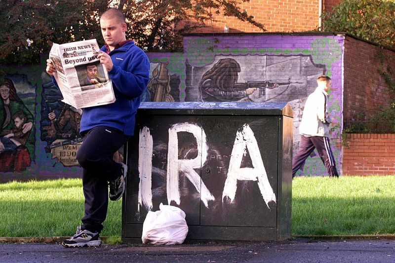 A man reads a local newspaper on Oct. 24, 2001 in Andersontown in West Belfast, Northern Ireland.