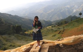 This picture taken on October 23, 2012 shows an ethnic Hmong hill tribe girl talking on a cell phone  in the mountainous district of Mu Cang Chai, in northwestern Vietnam.