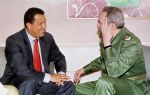 Venezuelan President Hugo Chavez (L) speaks with Cuban President Fidel Castro (R) on 16 April, 1999,