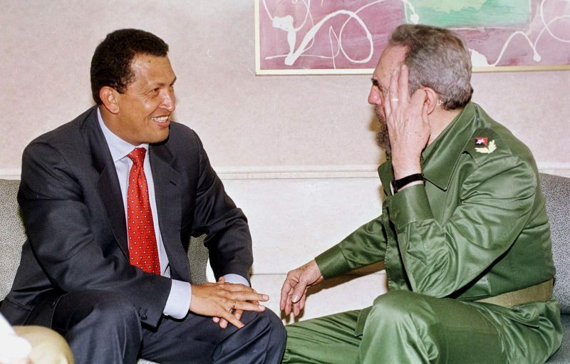 Venezuelan President Hugo Chavez (L) speaks with Cuban President Fidel Castro (R) on 16 April, 1999,