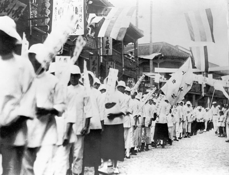 "Chinese students march with banners reading ""Down with the traitors who buy Japanese goods"" during demonstrations in Shanghai in 1919."