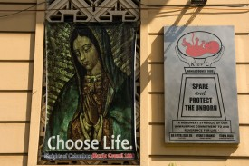 An anti-abortion poster showing a painting of the Virgin Mary on the Manila building of the Knights of Columbus, a Roman Catholic organisation, on May 19, 2014.