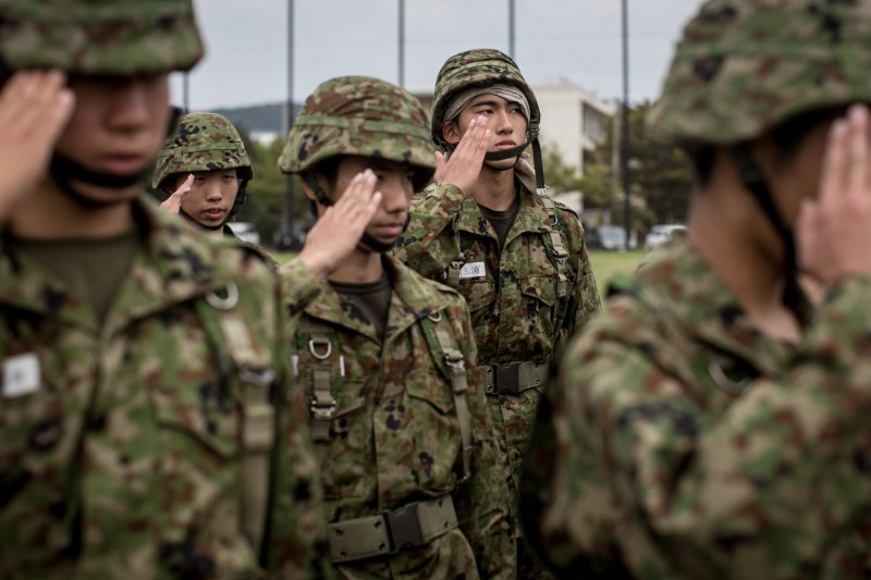 Students salute their teacher after finishing rifle training at the Japan Ground Self-Defense Force High Technical School in Yokosuka on Sept. 17, 2014.