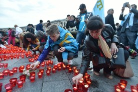 Crimean Tatars light candles during a memorial ceremony in Kiev on May 18, 2016, in commemoration of the 72nd anniversary of the deportation of the indigenous population of Crimea by the Soviet Union.
